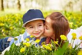foto of orchard  - Girl kissing a boy in a blossoming orchard - JPG