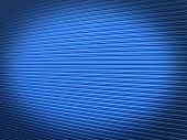 stock photo of roller shutter door  - blue painted galvanised steel warehouse roller shutter background with an abstract diminishing perspective and an added shadow vignette - JPG
