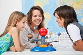 stock photo of earth mars jupiter saturn uranus  - Kids having fun studying the solar system  - JPG