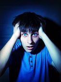 picture of scared  - Toned Photo of Scared Teenager in the Dark Room - JPG