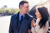 foto of flirt  - Laughing young couple flirting outdoors - JPG