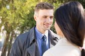 stock photo of flirt  - Happy beautiful couple flirting outdoors - JPG