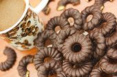 pic of biscuits  - Coffee and delicious chocolate biscuits on table closeup - JPG