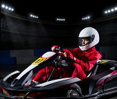 pic of armored car  - Young girl karting racer at stadium - JPG
