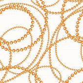 stock photo of beads  - Beautiful seamless background with threads of orange and blue beads on a beige background - JPG