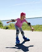 picture of inline skating  - Little girl is learning to roller skate - JPG