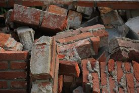picture of dumpster  - Bricks in a dumpster near a construction site home renovation - JPG