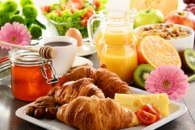 foto of orange  - Breakfast consisting of fruits orange juice coffee honey bread and egg. Balanced diet. ** Note: Shallow depth of field - JPG