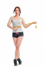 image of emaciated  - emaciated happy girl with centimeter at the waist - JPG