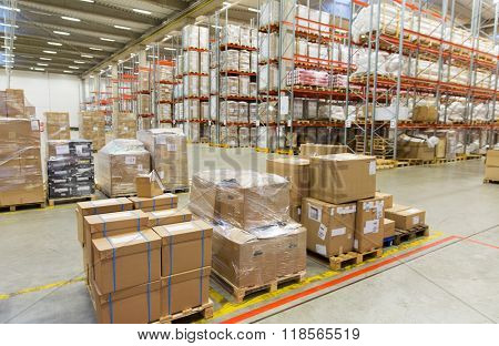 logistic, storage, shipment, industry and manufacturing concept - cargo boxes storing at warehouse s