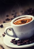 Постер, плакат: Coffee Cup of black coffee and spilled coffee beans Coffee break