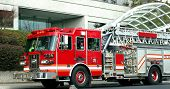 picture of firehose  - a red fire truck at the scene of an emergency - JPG