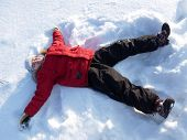 Winter Holidays. The Boy Lay On The Snow