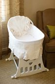 stock photo of bassinet  - Baby bassinet in the bedroom - JPG