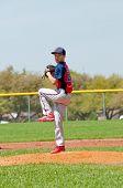 Постер, плакат: Baseball pitcher standing on the mound