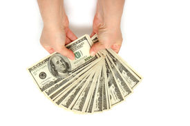 picture of holding money  - Businesswoman holding hundred dollar bills - JPG