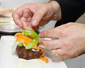 stock photo of chateaubriand  - Chef is decorating meat with steamed vegetables - JPG