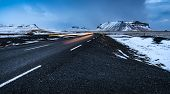 Beautiful winter landscape, empty highway with snowy roadside around it, wintertime road trip vacati poster
