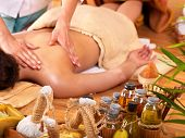 picture of thai massage  - Young woman getting massage in bamboo spa - JPG