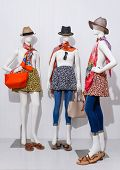 female clothing in skirt,jeans with hat and bag ,scarf, sunglasses on three mannequin