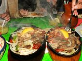 pic of mexican food  - Hot dishes of Mexican food on a table in restaurant - JPG