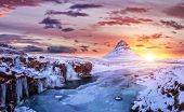Kirkjufell mountain with frozen water falls in winter, Iceland. One of the famous natural heritage i poster