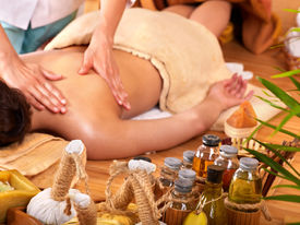 image of thai massage  - Young woman getting massage in bamboo spa - JPG