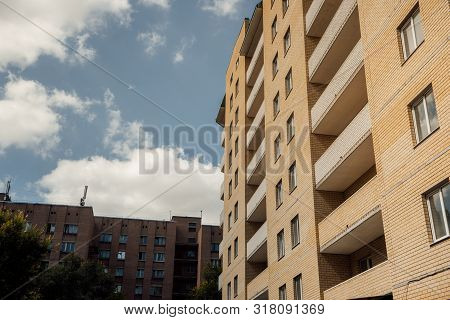poster of Modern Apartment Buildings On A Sunny Day With A Blue Sky. Facade Of A Modern Apartment Building. Re