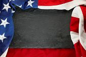 US American flag on black slate stone background. For USA Memorial day, Veterans day, Labor day, or poster