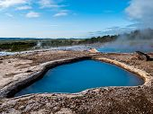 Blue Geothermal Pond At The Great Geysir, An Active Volcanic Geyser In Southwestern Iceland poster