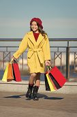 Child Stylish Hold Bunch Shopping Bags. Girl Cute Little Lady Coat And Beret Carry Shopping Bags. Sp poster
