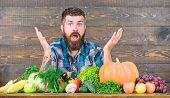 Surprised Man Chef With Rich Autumn Crop. Organic And Natural Food. Happy Halloween. Seasonal Vitami poster