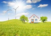 foto of natural resources  - house in spring landscape with wind turbines - JPG