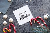 New Year And Christmas Background With Word Hello Winter. Christmas Candy Cane Gingerbread On Black  poster