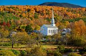 Iconic New England church in Stowe town at autumn in Vermont, USA  poster