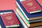 Two Foreign Passports Of Russians Are On Different Stacks Of Book In The Passport Invested Money For poster