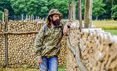 Man Bearded Backpacker Wear Camouflage Jacket Nature Background. Hiker Tourist. Brutal Manly Guy. Hi poster
