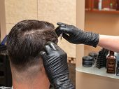Hairstylist Working With Scissors And Comb, Close Up View. Stylists Hands In Black Rubber Gloves. In poster