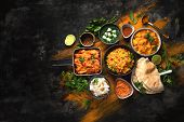 Assorted Indian Food On Black Background.. poster