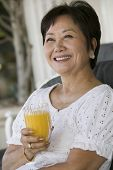 picture of early 60s  - Woman Drinking Orange Juice - JPG