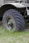 image of humvee  - close up of a military truck front wheel - JPG