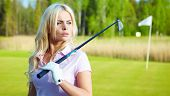 stock photo of ladies golf  - Young blonde  woman with golf equipment - JPG
