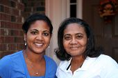image of mother daughter  - Happy minority family together outside their home - JPG