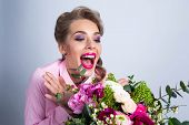 Young Beautiful Woman Look At Bouquet Of Flowers Very Happy And Excited Screaming In Joy poster