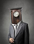 pic of pendulum clock  - Businessman with old pendulum instead of his head - JPG