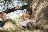 Sad Girl Feeling Alone In The Park. Lonely Concepts. Beautiful Toddler Girl And Fluffy Stay Alone Un poster