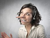 image of receptionist  - Smiling insincere receptionist with long nose talking on the telephone - JPG