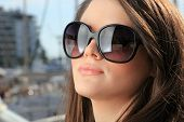 stock photo of piraeus  - Young woman at the port of Piraeus Greece - JPG