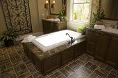 picture of model home  - Designer bathroom with a modern tub and tile floor - JPG