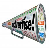 stock photo of attention  - A bullhorn megaphone covered with words describing advertising such as advertise - JPG